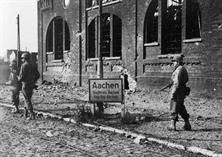 OCT 1944, THE BRAVE SOLDIERS OF THE 26TH INFANTRY WAS FIGHTING THROUGH THE CITY OF AACHEN. THE ATTACHED PHOTO SCENE WAS TAKEN IN THE NORTHERN PART OF THE CITY. THE SOLDIERS BELONGED TO LT. COL